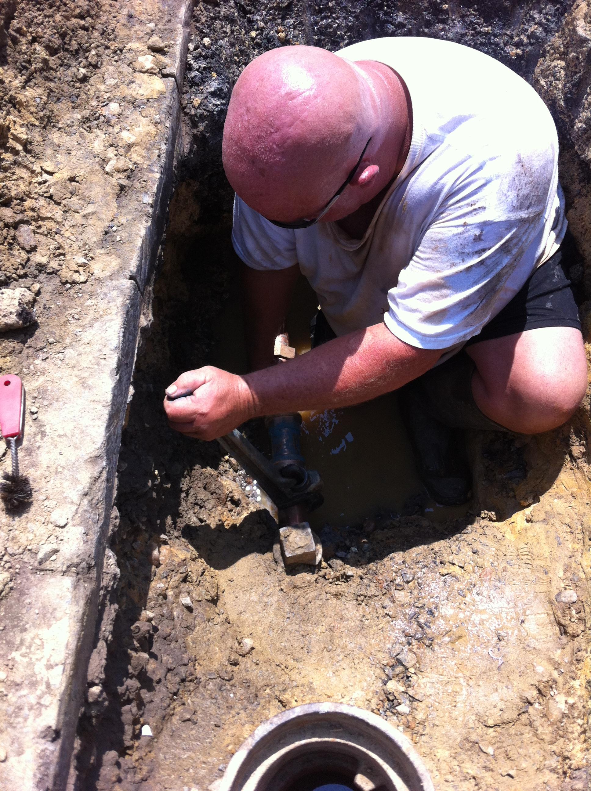 man digging in dirt