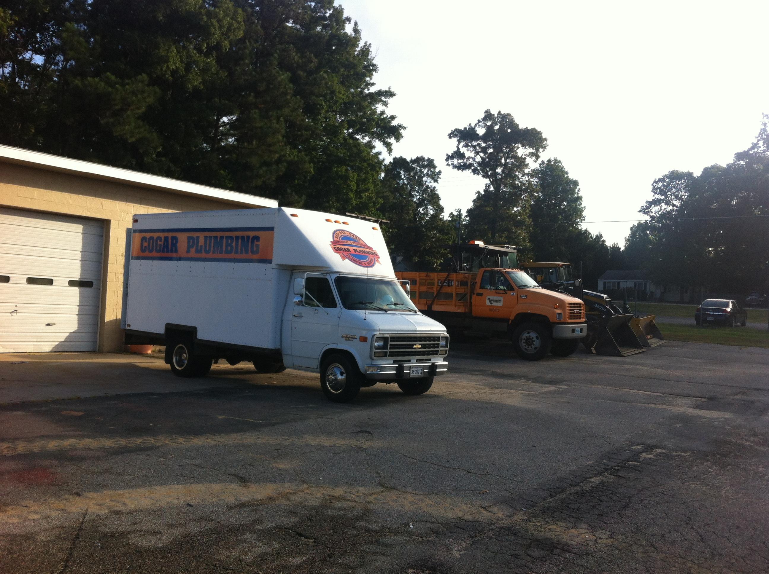Trucks outside of garage