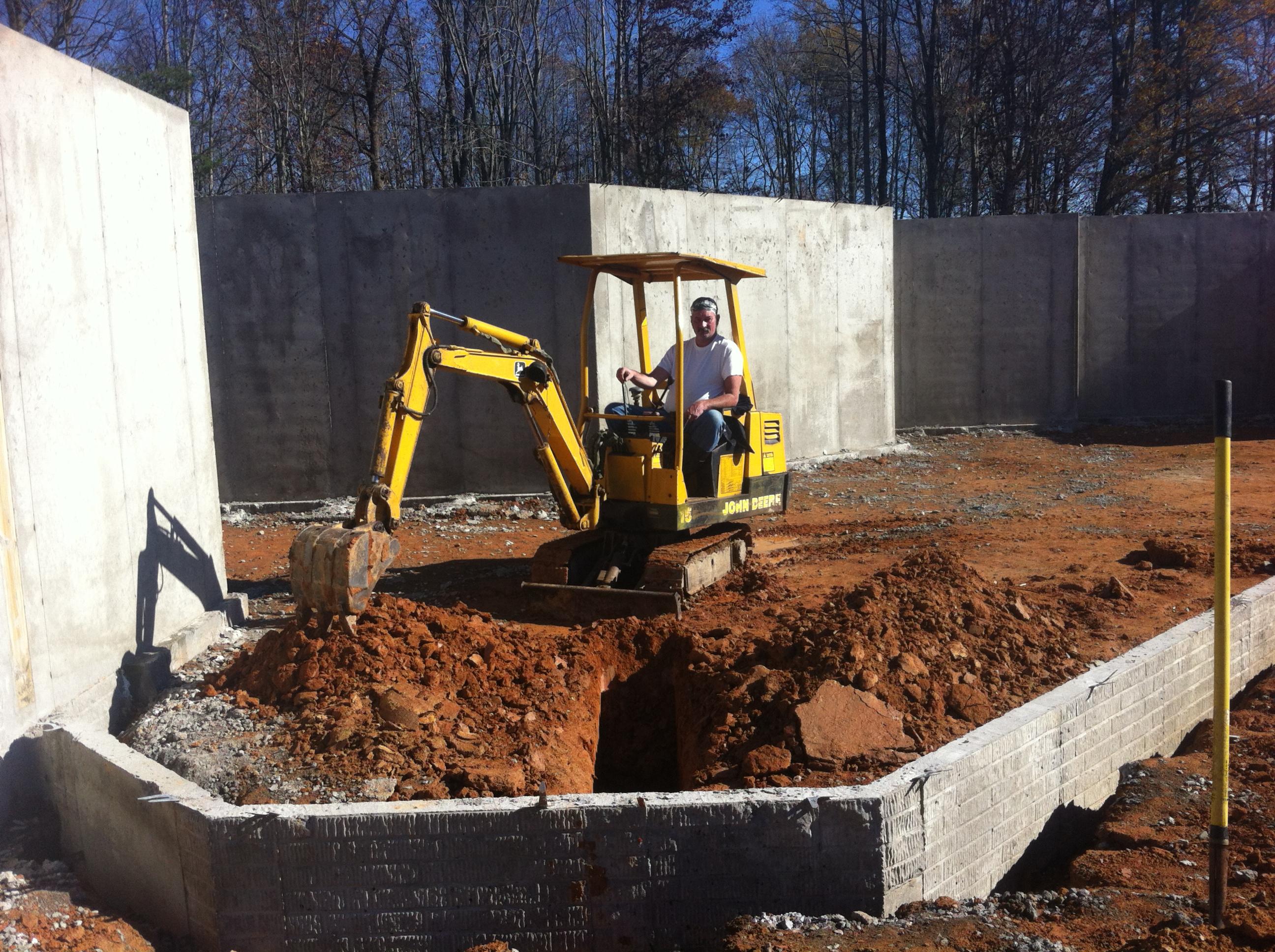 man operating excavator