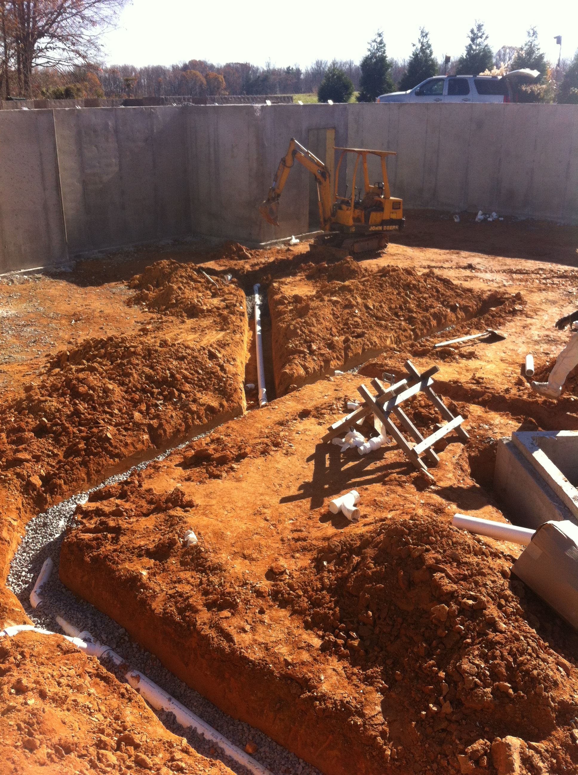 excavator clearing room for pipe