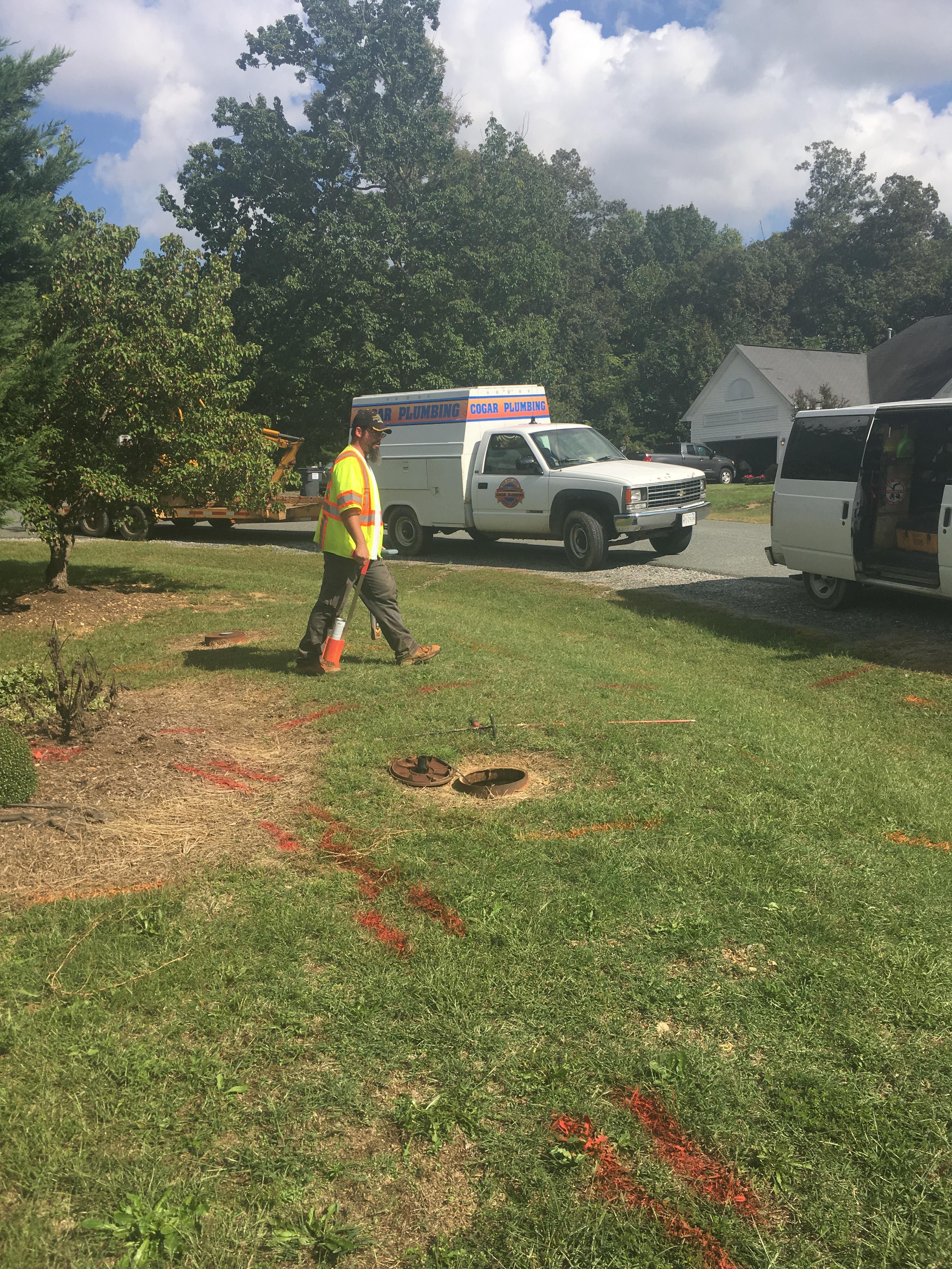 Plumber working in yard
