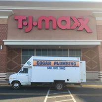 Truck next to T J Maxx